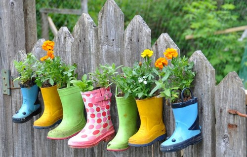 rainboot-garden-on-a-fence-500x319